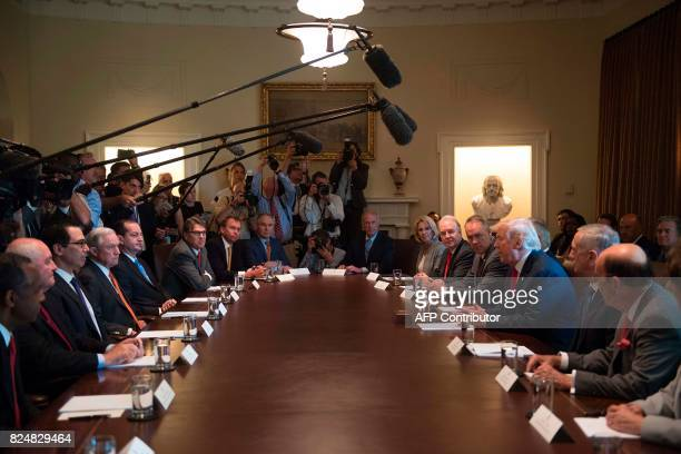 US President Donald Trump speaks during a cabinet meeting at the White House in Washington DC on July 31 2017 John Kelly was sworn in Monday as the...