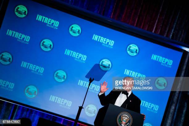 US President Donald Trump speaks during a dinner to commemorate the 75th anniversary of the Battle of the Coral Sea during WWII onboard the Intrepid...