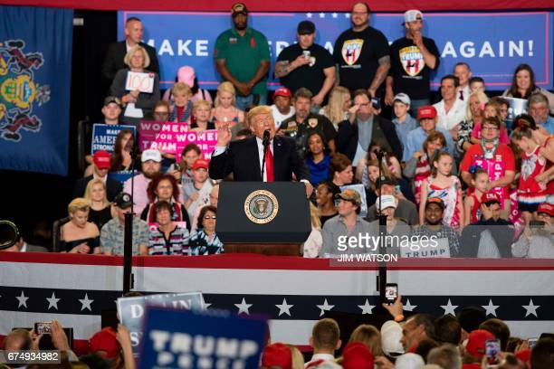 US President Donald Trump speaks during a 'Make America Great Again' rally in Harrisburg PA April 29 marking Trump's 100th day in office / AFP PHOTO...