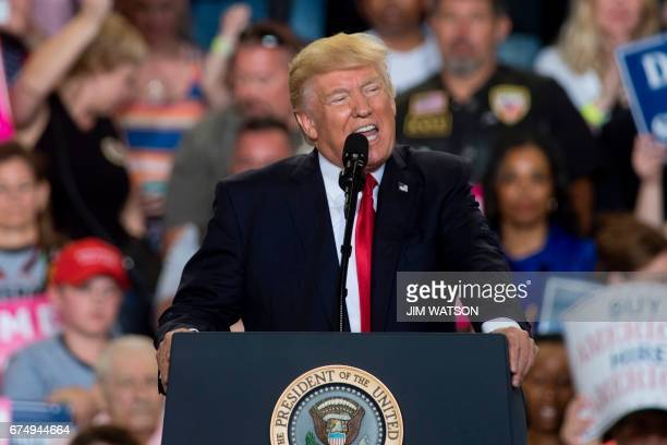 US President Donald Trump speaks during a 'Make America Great Again' rally in Harrisburg PA April 29 marking his 100th day in office / AFP PHOTO /...