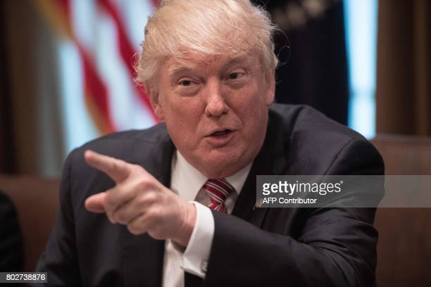 US President Donald Trump speaks during a meeting to urge passage of bills to enforce federal laws on immigration in the Cabinet Room at the White...