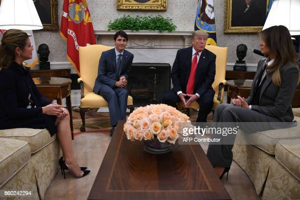 US President Donald Trump speaks during a meeting with First Lady Melania Trump Canadian Prime Minister Justin Trudeau and his wife Sophie Gregoire...