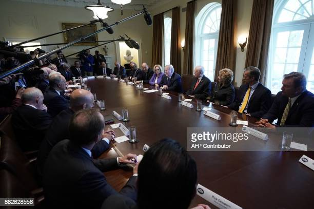 US President Donald Trump speaks during a meeting with members of the the Senate Finance Committee and his economic team in the Cabinet Room of the...