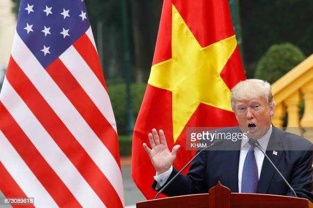 President Donald Trump speaks during a news conference at the Presidential Palace in Hanoi on November 12 2017 Trump told his Vietnamese counterpart...