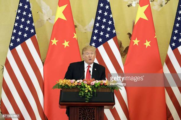 US President Donald Trump speaks during a news conference with Xi Jinping China's president not pictured at the Great Hall of the People in Beijing...