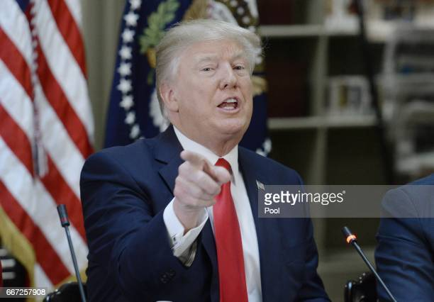 President Donald Trump speaks during a strategic and policy discussion with CEOs in the State Department Library in the Eisenhower Executive Office...
