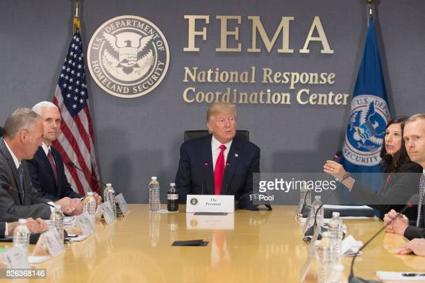 US President Donald Trump speaks during a visit to Federal Emergency Management Agency headquarters with US Vice President Mike Pence US Interior...