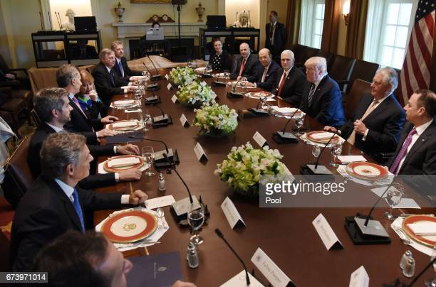 US President Donald Trump speaks during a working luncheon with President Mauricio Macri of Argentina in the Cabinet Room of the White House April 27...