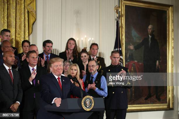 S President Donald Trump speaks during an event highlighting the opioid crisis in the US October 26 2017 in the East Room of the White House in...