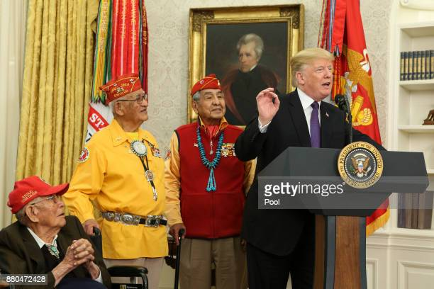 US President Donald Trump speaks during an event honoring members of the Native American code talkers in the Oval Office of the White House on...
