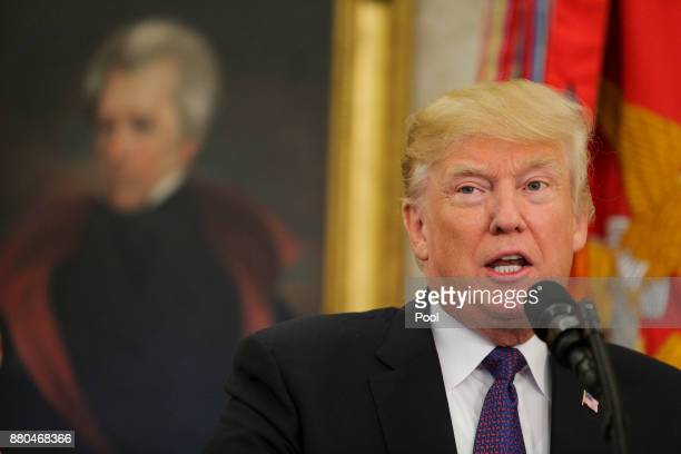 US President Donald Trump speaks during an event with members of the Native American code talkers in the Oval Office of the White House on November...