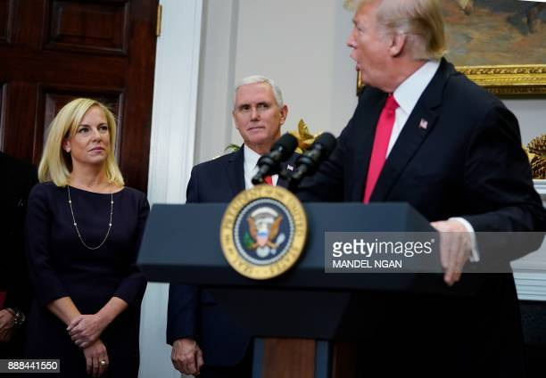 US President Donald Trump speaks during the swearingin ceremony for Homeland Security Secretary Kirstjen Nielsen as Vice President Mike Pence watches...