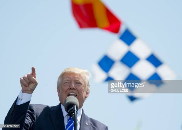 US President Donald Trump speaks during the US Coast Guard Academy Commencement Ceremony in New London Connecticut May 17 2017 / AFP PHOTO / SAUL LOEB