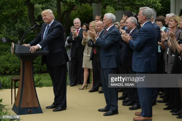 US President Donald Trump speaks in the Rose Garden of the White House following the House of Representative vote on the health care bill on May 4...