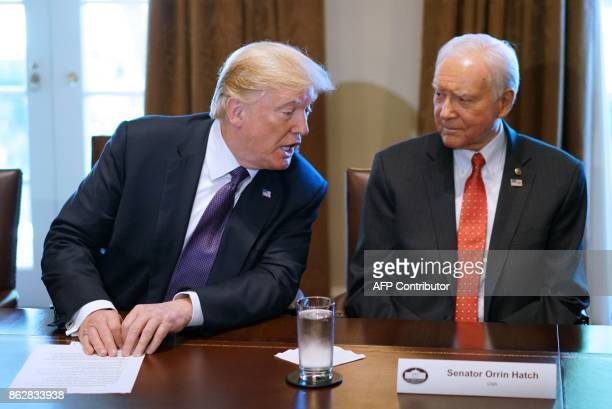 US President Donald Trump speaks nex to Senate Finance Committee Chairman Orin Hatch RUT during a meeting with members of the the Senate Finance...