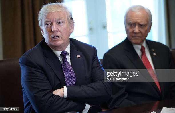 US President Donald Trump speaks next to Senate Finance Committee Chairman Orin Hatch RUT during a meeting with members of the the Senate Finance...