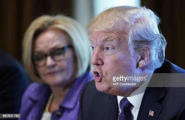 US President Donald Trump speaks next to Senator Claire McCaskill of Missouri during a meeting with members of the the Senate Finance Committee in...