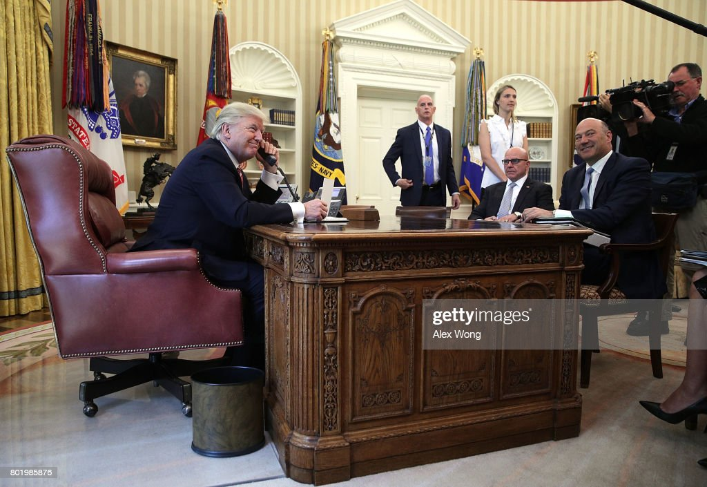 U.S. President Donald Trump (L) speaks on the phone with Irish Prime Minister Leo Varadkar on the phone as National Economic Council Director Gary Cohn (R) and National Security Adviser H. R. McMaster (2nd R) look on in the Oval Office of the White House June 27, 2017 in Washington, DC. President Trump congratulated Prime Minister Varadkar to become the new leader of Ireland.