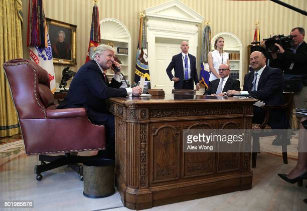S President Donald Trump speaks on the phone with Irish Prime Minister Leo Varadkar on the phone as National Economic Council Director Gary Cohn and...