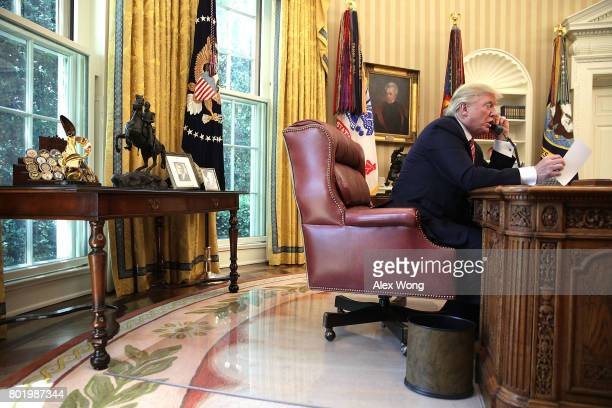 S President Donald Trump speaks on the phone with Irish Prime Minister Leo Varadkar on the phone in the Oval Office of the White House June 27 2017...
