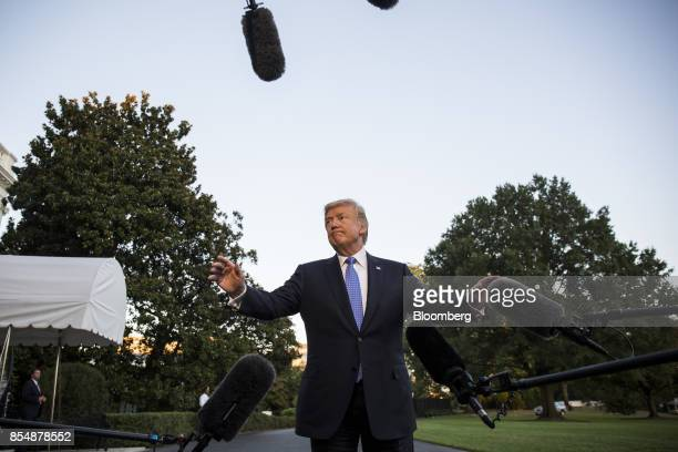 US President Donald Trump speaks to members of the media after returning to the White House in Washington DC US on Sept 27 2017 Trump called the tax...