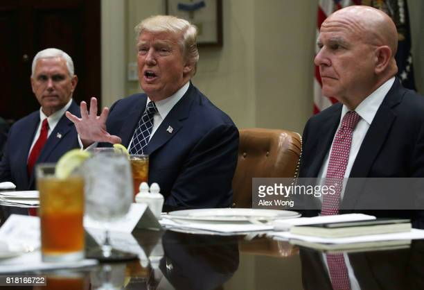 S President Donald Trump speaks to members of the media as Vice President Mike Pence and National Security Adviser HR McMaster listen during a lunch...