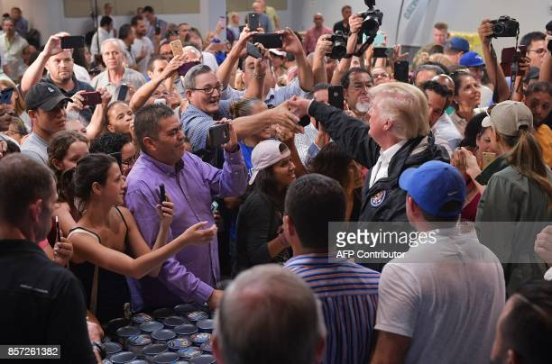 US President Donald Trump speaks to people as he visits the Cavalry Chapel in Guaynabo Puerto Rico on October 3 2017 Nearly two weeks after Hurricane...