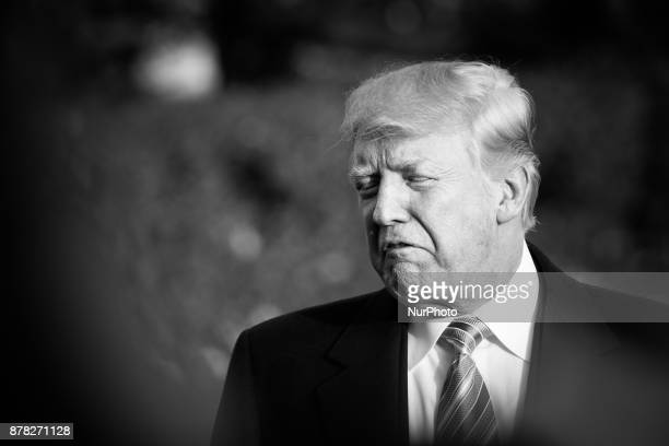 President Donald Trump speaks to reporters before leaving the White House with his family as they depart for the Thanksgiving Holiday from the South...