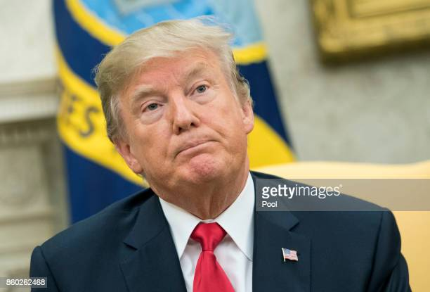 US President Donald Trump speaks to reporters during a meeting with Canadian Prime Minister Justin Trudeau First Lady Melania Trump and Trudeau's...