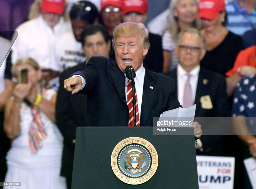 U.S. President Donald Trump speaks to supporters at the Phoenix Convention Center during a rally on August 22, 2017 in Phoenix, Arizona. An earlier statement by the president that he was considering a pardon for Joe Arpaio,, the former sheriff of Maricopa County who was convicted of criminal contempt of court for defying a court order in a case involving racial profiling, has angered Latinos and immigrant rights advocates.