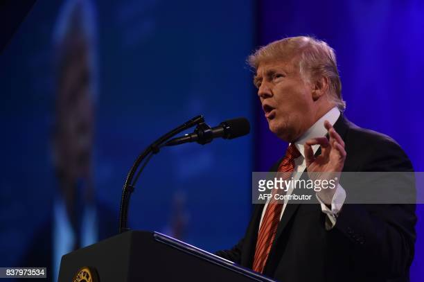 US President Donald Trump speaks to the American Legion national convention on August 23 2017 in Reno Nevada / AFP PHOTO / Nicholas Kamm