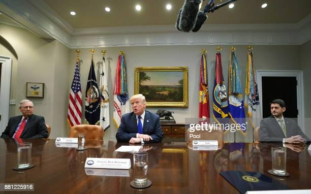 US President Donald Trump speaks to the media as Senate Majority Leader Mitch McConnell RKY and Speaker of the House Paul Ryan RWI look on during a...