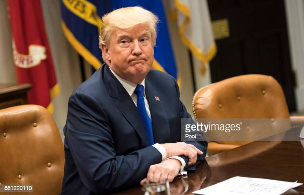 US President Donald Trump speaks to the media during a meeting with congressional leadership in the Roosevelt Room at the White House on November 28...