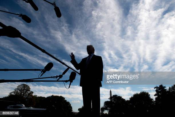 US President Donald Trump speaks to the media prior to boarding Marine One and departing from the South Lawn of the White House in Washington DC...