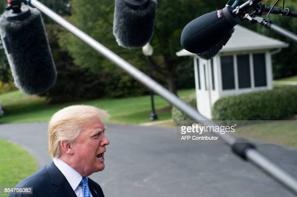 US President Donald Trump speaks to the media prior to departing on Marine One from the South Lawn of the White House in Washington DC September 27...