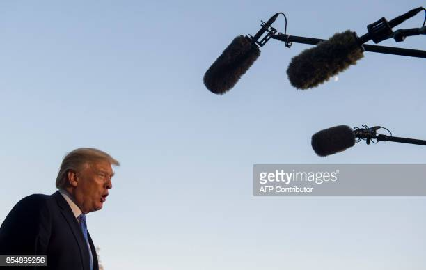 US President Donald Trump speaks to the press after arriving on Marine One on the South Lawn of the White House in Washington DC September 27 after...