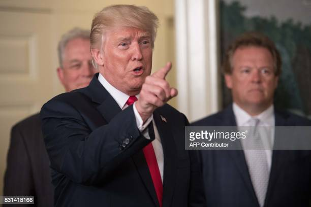 US President Donald Trump speaks to the press after signing a memorandum on addressing Chinas laws policies practices and actions related to...