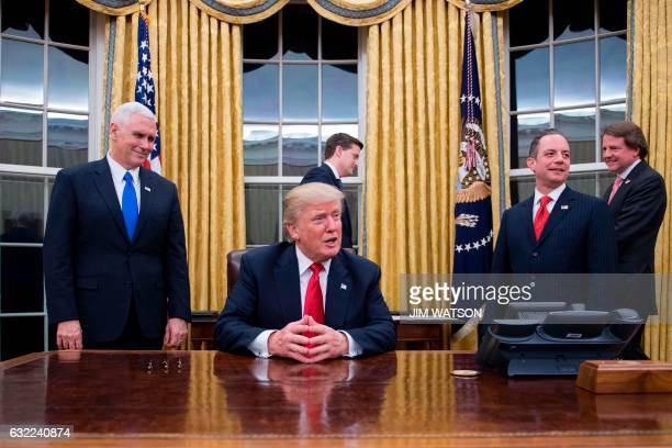 President Donald Trump speaks to the press as he waits at his desk before signing conformations for General James Mattis as US Secretary of Defense...