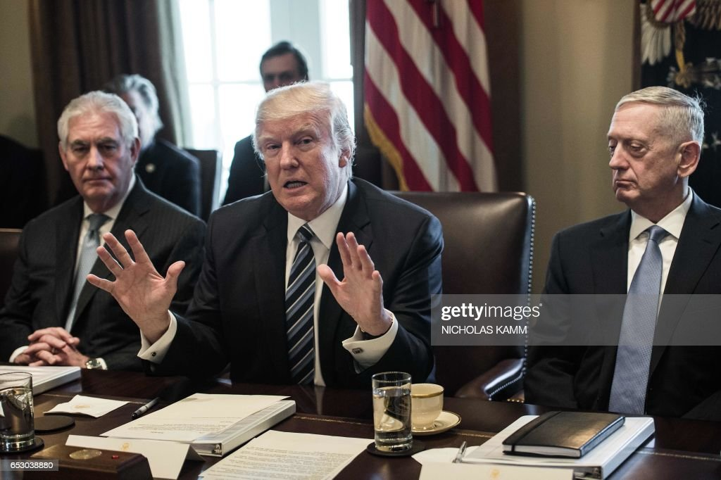 US President Donald Trump speaks to the press with Secretary of State Rex Tillerson (L) and Defense Secretary James Mattis (R) as he meets with his Cabinet in the Cabinet Room at the White House in Washington, DC, on March 13, 2017. /