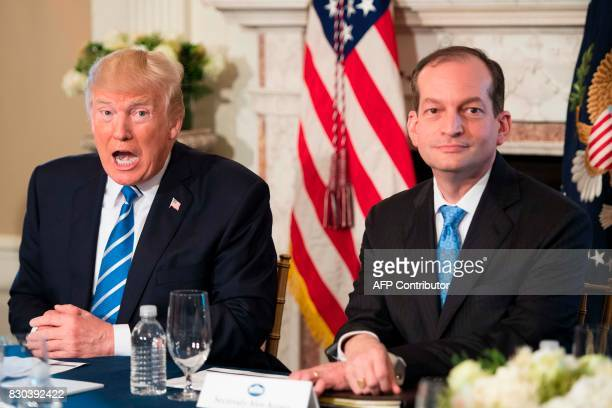 US President Donald Trump speaks to the press with US Labor Secretary Alexander Acosta on August 11 at his Bedminster National Golf Club in New...