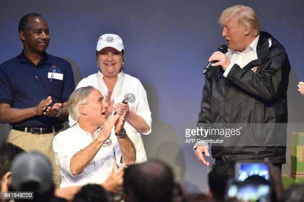 US President Donald Trump speaks to volunteers at the First Church of Pearland on September 2 while visiting areas affected by Hurricane Harvey With...
