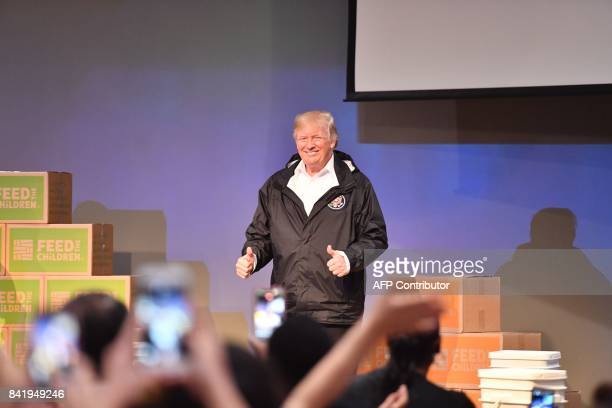 US President Donald Trump speaks to volunteers at the First Church of Pearland on September 2 while visiting areas affected by Hurricane Harvey / AFP...