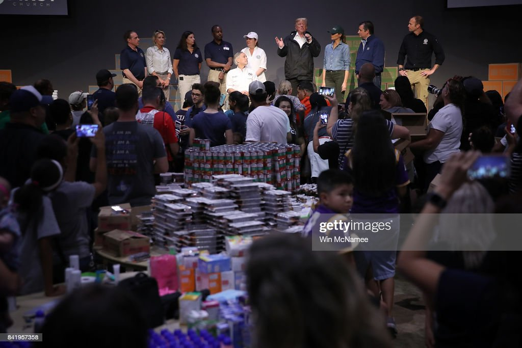 U.S. President Donald Trump speaks to volunteers packing emergency supplies for residents impacted by Hurricane Harvey at the First Church of Pearland September 2, 2017 in Pearland, Texas. Pearland, just south of Houston, was heavily damaged by the floodwaters created by the hurricane. Also pictured are Texas Gov. Greg Abbott, Cecilia Abbott, first lady Melania Trump, and Sen. Ted Cruz (R-TX).