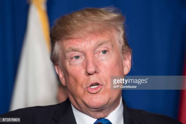 US President Donald Trump speaks while participating in a veterans meet and greet on the sidelines of the AsiaPacific Economic Cooperation leaders'...