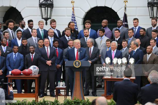President Donald Trump speaks while the Super Bowl Champion New England Patriots stand behind him during a ceremony at the White House in Washington...
