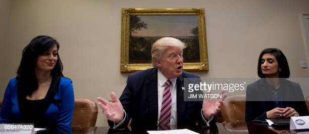 US President Donald Trump speaks with Administrator of the Centers for Medicare and Medicaid Services Seema Verna and Dr Parmis Khatibiis an...