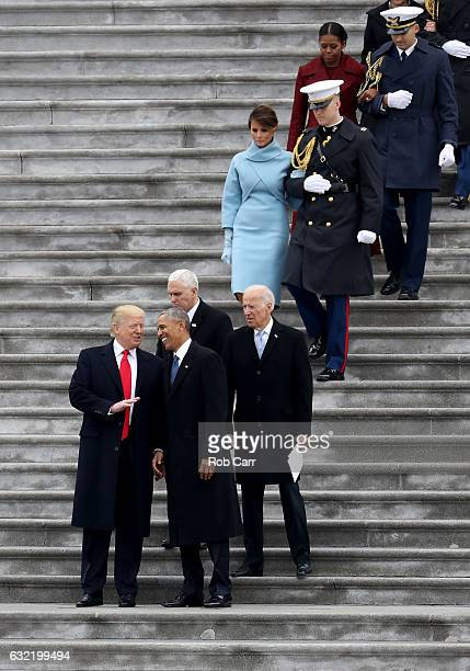President Donald Trump speaks with former president Barack Obama as Vice President Mike Pence and former vice president Joe Biden look on on the...
