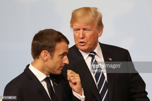 President Donald Trump speaks with French President Emmanuel Macron after posing for the family photo at the start of the the G20 summit on July 7...