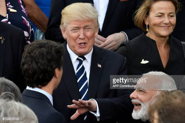 US President Donald Trump speaks with India's Prime Minister Narendra Modi and Canada's Prime Minister Justin Trudeau prior to a concert at the...