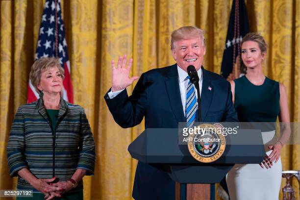 US President Donald Trump speaks with Ivanka Trump and SBA Administrator Linda McMahon during an event with small businesses at the White House in...